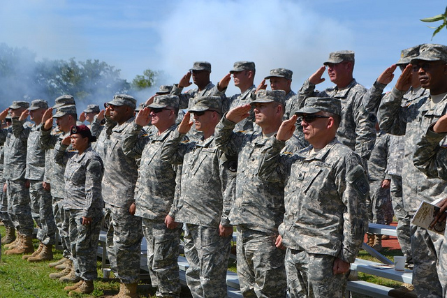 Soldiers standing at attention during the changing of command at Ft. Bragg