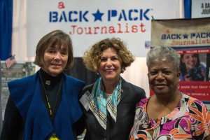 """Linda Dennis, Mrs. Linda Odierno, """"Mama"""" Lynch at AUSA booth for A Backpack Journalist"""