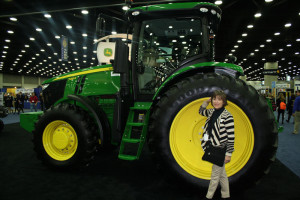 """Ms. D standing next to the """"big"""" tire - tractor"""